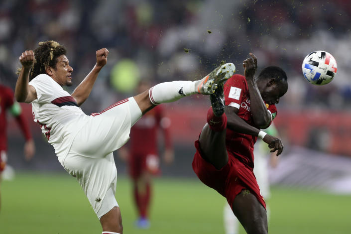 Flamengo's Willian Arao, left, vies for the ball with Liverpool's Sadio Mane during the Club World Cup final soccer match between Liverpool and Flamengo at Khalifa International Stadium in Doha, Qatar, Saturday, Dec. 21, 2019. (AP Photo/Hussein Sayed)