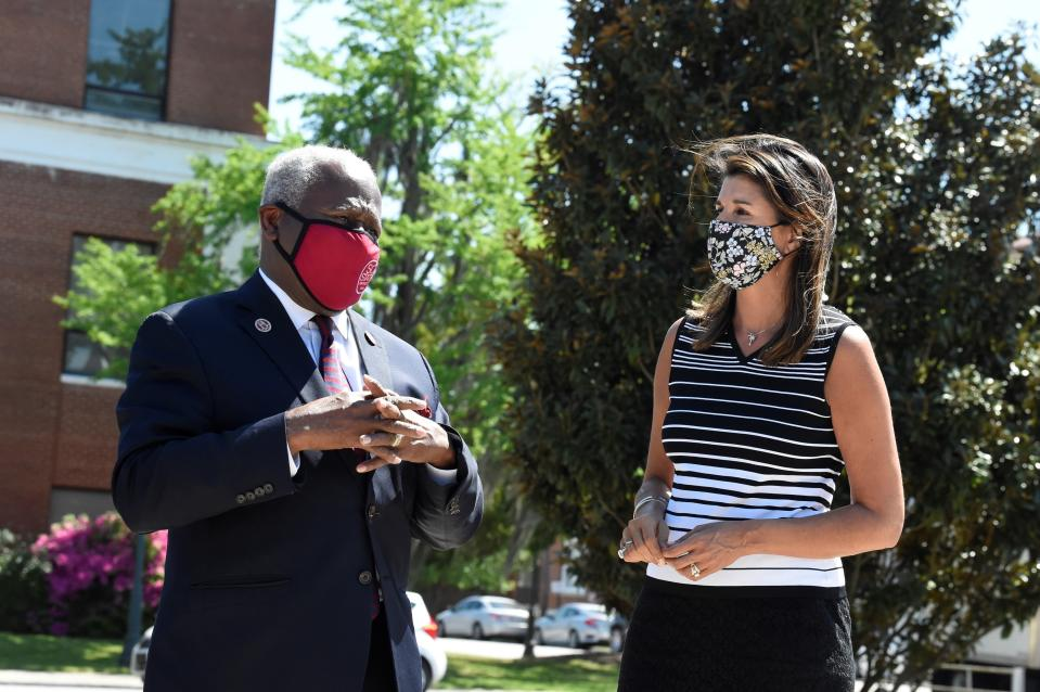 Former South Carolina Gov. Nikki Haley, right, stands with South Carolina State University President James Clark, left, during a tour of the HBCU's campus on Monday, April 12, 2021, in Orangeburg, S.C. Haley, often mentioned as a possible 2024 GOP presidential contender, said Monday that she would not seek her party's nomination if former President Donald Trump opts to run a second time. (AP Photo/Meg Kinnard)