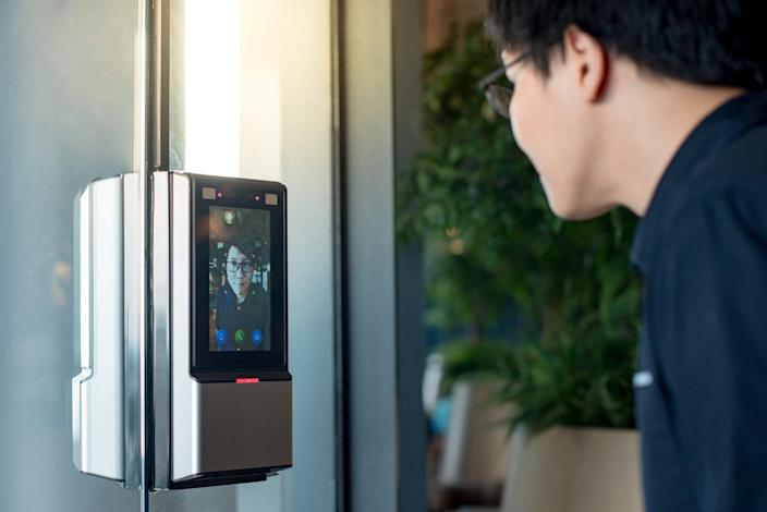 Employee uses facial recognition technology to gain access to his office building.