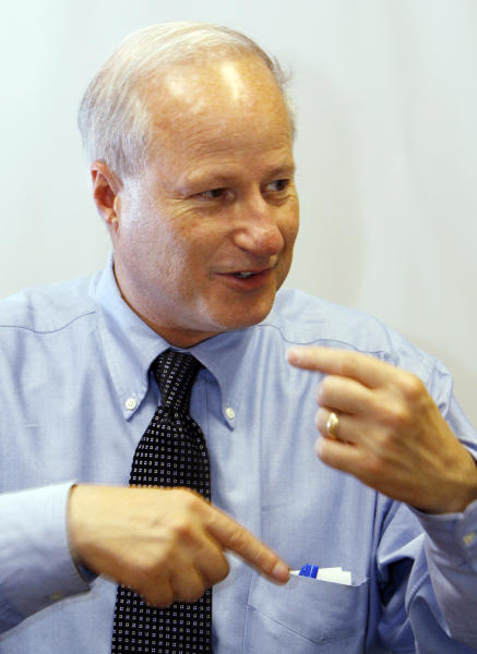 """FILE - In this Aug. 28, 2009 file photo, U.S. Rep. Mike Coffman, R-Colo., responds to questions during an interview with Associated Press reporters in Denver. Missouri congressman and Republican Senate candidate Todd Akin's comments on rape are playing a role in more than dozen House races in battleground states. Coffman's Democratic opponent, Joe Mikosi, began tying his opponent Coffman to Akin within hours of learning about his comments this past Sunday. Coffman responded by calling for Akin to leave the race and decrying his rape comments as """"wrong, inappropriate and hurtful to women across the country."""" (AP Photo/Ed Andrieski, File)"""