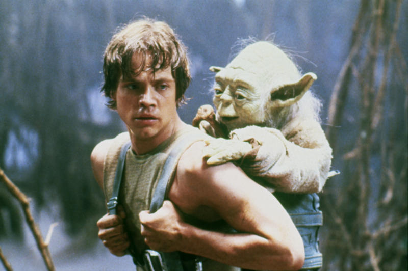 Mark Hamill with Yoda on the set of 'Star Wars: Episode V - The Empire Strikes Back'. (Photo by Lucasfilm/Sunset Boulevard/Corbis via Getty Images)
