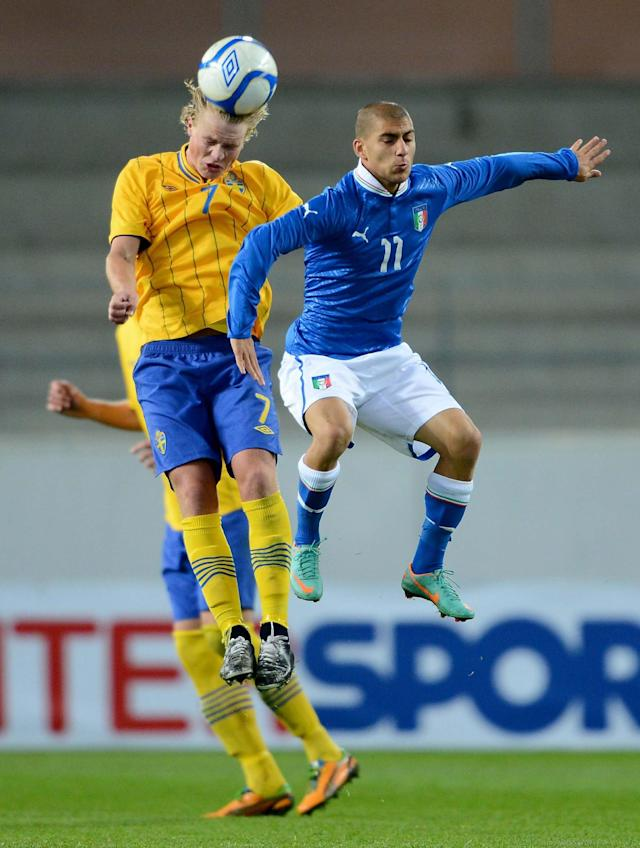 Sweden's Oscar Hiljemark (L) goes for a header with Italy's Giuseppe De Luca during the UEFA European Under-21 Championship qualification match between Sweden and Italy at the Guldfageln arena in Kalmar, on October 16, 2012. AFP PHOTO/SCANPIX-SWEDEN/ Patric SoderstromPatric Soderstrom/AFP/Getty Images