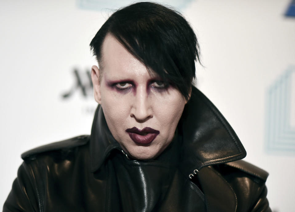 """FILE - In this Dec. 10, 2019, file photo, Marilyn Manson attends the 9th annual """"Home for the Holidays"""" benefit concert in Los Angeles. On Friday, July 2, 2021, Manson, born Brian Hugh Warner, turned himself in to law enforcement in Los Angeles, in relation to a 2019 arrest warrant for acts alleged to have occurred while performing a concert in Gilford, NH. Warner was processed and released on personal recognizance bail. (Photo by Richard Shotwell/Invision/AP, File)"""