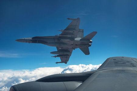 FILE PHOTO: Royal Canadian Air Force CF-18 Hornets depart after refueling with a  KC-135 Stratotanker assigned to the 340th Expeditionary Air Refueling Squadron over Iraq October 30, 2014.    REUTERS/U.S. Air Force/Staff Sgt. Perry Aston/Handout via Reuters/File Photo