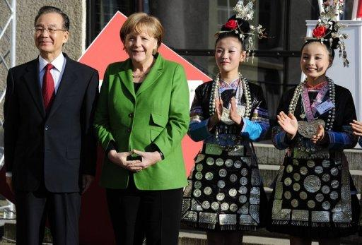 German Chancellor Angela Merkel (2nd L) and Chinese Premier Wen Jiabao (L) at the opening of the Hannover Messe on April 22. Having already inked an accord with Iceland on cooperation in the oil-rich Arctic region and opened the Hannover Messe, Wen will now turn his attention to the Europe's up-and-coming ex-communist East