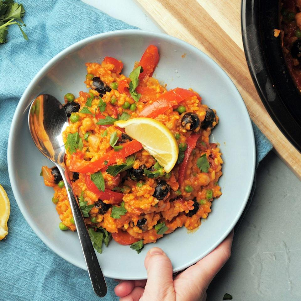 "<p>Try our spiced <a href=""https://www.goodhousekeeping.com/uk/food/recipes/g538754/best-slow-cooker/"" rel=""nofollow noopener"" target=""_blank"" data-ylk=""slk:slow cooker"" class=""link rapid-noclick-resp"">slow cooker</a> <a href=""https://www.goodhousekeeping.com/uk/food/recipes/a536844/spanish-chicken-stew/"" rel=""nofollow noopener"" target=""_blank"" data-ylk=""slk:Spanish"" class=""link rapid-noclick-resp"">Spanish</a>-style rice this week. Paella <a href=""https://www.goodhousekeeping.com/uk/food/recipes/a553950/parsley-wild-rice/"" rel=""nofollow noopener"" target=""_blank"" data-ylk=""slk:rice"" class=""link rapid-noclick-resp"">rice</a> is cooked in chopped tomatoes, stock and wine, with olives, <a href=""https://www.goodhousekeeping.com/uk/food/recipes/a566758/sweet-potato-toasts-with-chickpeas/"" rel=""nofollow noopener"" target=""_blank"" data-ylk=""slk:chickpeas"" class=""link rapid-noclick-resp"">chickpeas</a>, peppers and peas. If you prefer a looser rice dish, simply stir through some more hot stock at the end of cooking. </p><p><strong>Recipe: Vegan Slow Cooker Spanish-style Rice</strong></p>"
