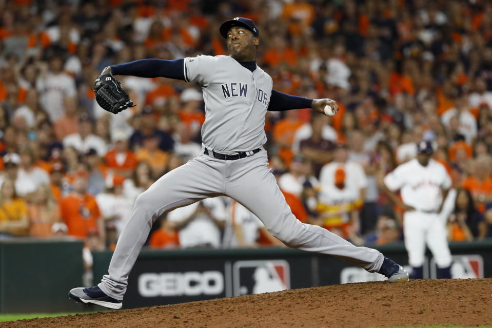 New York Yankees relief pitcher Aroldis Chapman throws against the Houston Astros during the ninth inning in Game 6 of baseball's American League Championship Series Saturday, Oct. 19, 2019, in Houston. (AP Photo/Matt Slocum)