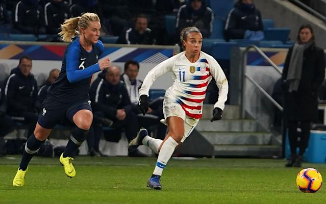 Mallory Pugh (right) and the United States are considered World Cup favorites along with Amandine Henry and France. (Getty)