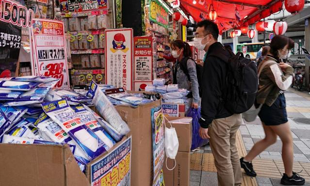 "<span class=""element-image__caption"">Masks and hand sanitiser on sale at a street stall in Tokyo.</span> <span class=""element-image__credit"">Photograph: Kimimasa Mayama/EPA</span>"