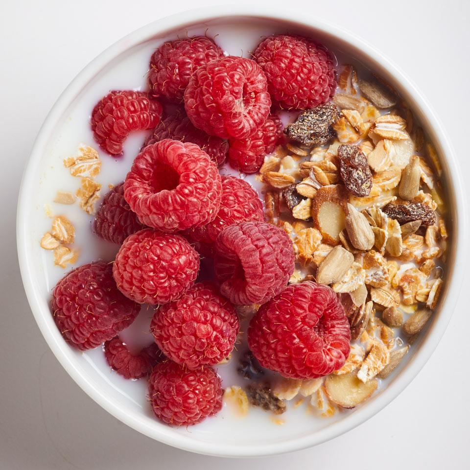 "<p>Unlike granola, muesli isn't baked with sweeteners or oil. Make your own or find your favorite brand in most supermarkets--we like Bob's Red Mill. <a href=""http://www.eatingwell.com/recipe/265712/muesli-with-raspberries/"" rel=""nofollow noopener"" target=""_blank"" data-ylk=""slk:View recipe"" class=""link rapid-noclick-resp""> View recipe </a></p>"