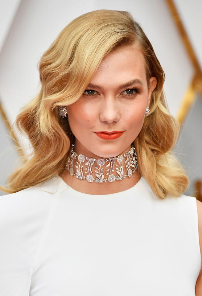 <p>The supermodel wore an oversized diamond choker and diamond earrings to the 2017 Oscars. (Photo: Getty Images) </p>