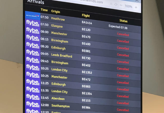 A flight departure shows cancelled Flybe flights at Belfast Airport on Thursday. (David Young/PA via AP)