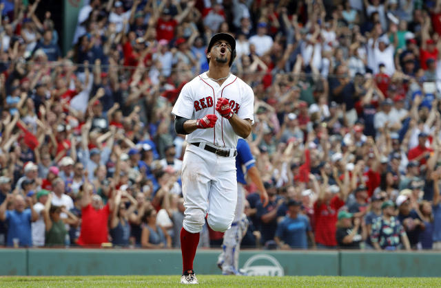 Boston Red Sox' Xander Bogaerts shouts while rounding the bases after hitting grand slam in the 10th inning of their 6-2 over the Toronto Blue Jays in a baseball game Saturday, July 14, 2018, in Boston. (AP Photo/Winslow Townson)