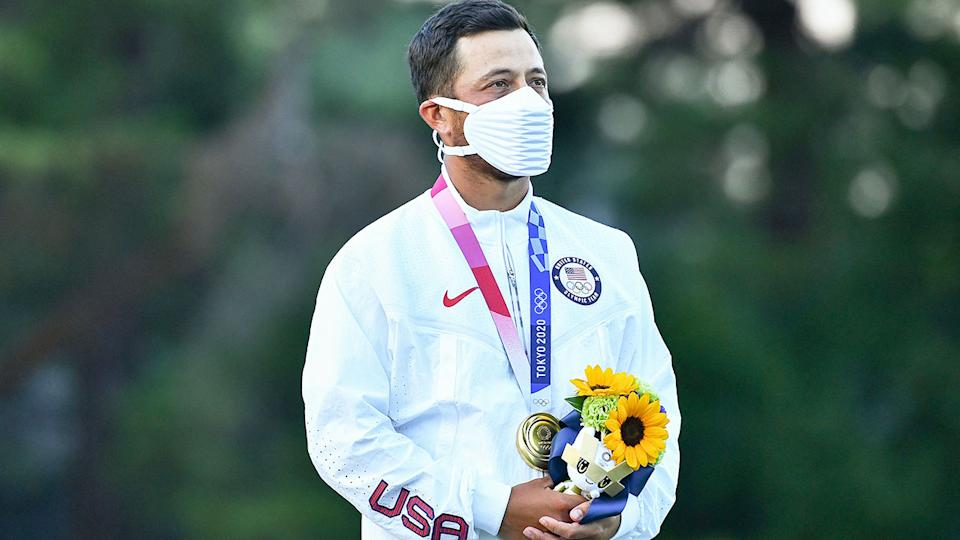 Seen here, Xander Schauffele stands atop the podium after winning Olympic gold in golf.
