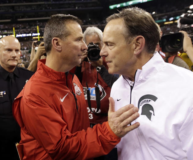 Urban Meyer (L) and Mark Dantonio meet Saturday in a game with conference and potential CFP implications.