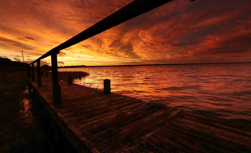 The sun sets over Lake Eustis in Tavares, Fla., following Hurricane Dorian's blow over Florida on Sept. 4, 2019. (Photo: Stephen M. Dowell/Orlando Sentinel/Tribune News Service via Getty Images)