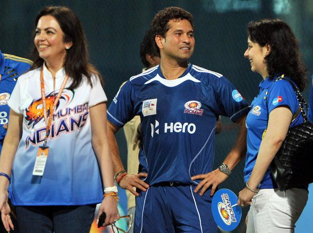 Mumbai Indians player Sachin Tendulkar (centre) team owner Nita Ambani (left) and Sachin's wife Anjali share a light moment after their team's victory in the Champions League Twenty20 second semi final match between Mumbai Indians and Somerset at the M.A Chidambaram Stadium in Chennai on October 8, 2011. Mumbai Indians will face Royal Challengers Bangalore (RCB) in the final match on October 9. AFP PHOTO/Manjunath KIRAN