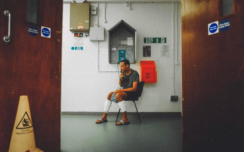 Aaron Harris in HMP Winchester, with bandages covering his legs where he has cut himself - Television Stills