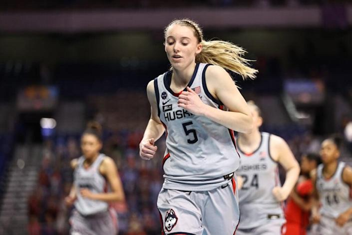 SAN ANTONIO, TEXAS – APRIL 02: Paige Bueckers #5 of the UConn Huskies runs off of the court after losing to the Arizona Wildcats in the Final Four semifinal game of the 2021 NCAA Women's Basketball Tournament at the Alamodome on April 02, 2021 in San Antonio, Texas. (Photo by Elsa/Getty Images)