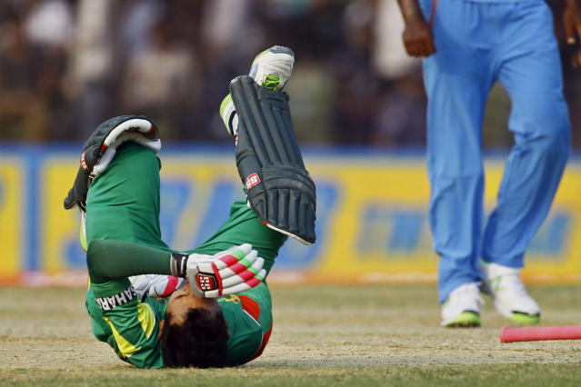 Bangladesh's Mushfiqur Rahim reacts in pain after he was hit by a ball during the Asia Cup one-day international cricket tournament against India in Fatullah, near Dhaka, Bangladesh, Wednesday, Feb. 26, 2014. (AP Photo/A.M. Ahad)