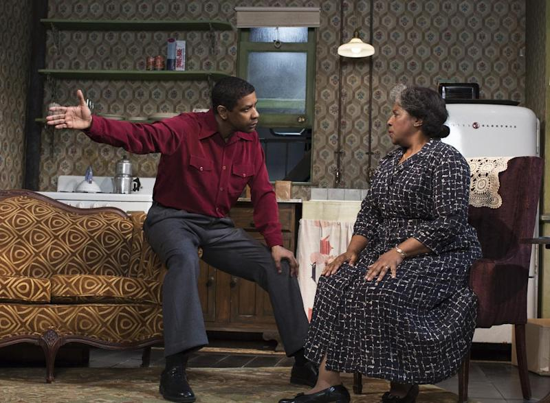"FILE - This file image released by Philip Rinaldi Publicity shows Denzel Washington, left, and LaTanya Richardson Jackson during a performance of ""A Raisin in the Sun,"" at the Ethel Barrymore Theatre in New York. This Broadway season has been rich with roles for African-Americans and audiences are responding, from the packed Brooks Atkinson Theatre, where the musical ""After Midnight"" celebrates Duke Ellington's years at the Cotton Club, to the standing-room only Circle in the Square, where Audra McDonald is channeling Billie Holiday, and to the Ethel Barrymore Theatre where Washington and Richardson share a stage with Anika Noni Rose and Sophie Okonedo. (AP Photo/Philip Rinaldi Publicity, Brigitte Lacombe, File)"