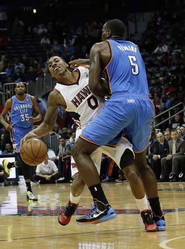 Atlanta Hawks point guard Jeff Teague (0) is fouled by Oklahoma City Thunder center Kendrick Perkins (5) in the first half of an NBA basketball game Tuesday, Dec. 10, 2013, in Atlanta. (AP Photo/John Bazemore)
