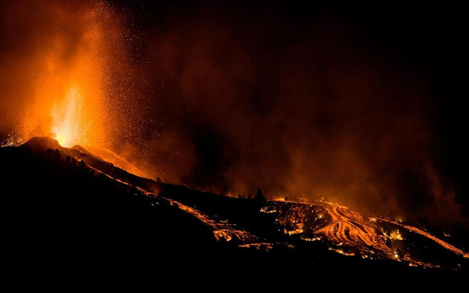 Lava flows from an eruption of a volcano at the island of La Palma - Jonathan Rodriguez/AP