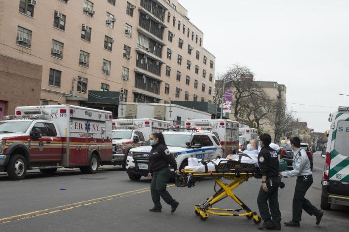 """<span class=""""caption"""">Outside Elmhurst Hospital's trauma unit, where ambulances drop off many of the sick during the worst weeks of the pandemic.</span> <span class=""""attribution""""><a class=""""link rapid-noclick-resp"""" href=""""https://www.gettyimages.com/detail/news-photo/the-scene-outside-of-elmhurst-hospitals-trauma-unit-remains-news-photo/1215793277?adppopup=true"""" rel=""""nofollow noopener"""" target=""""_blank"""" data-ylk=""""slk:Getty Images / Andrew Lichtenstein"""">Getty Images / Andrew Lichtenstein</a></span>"""