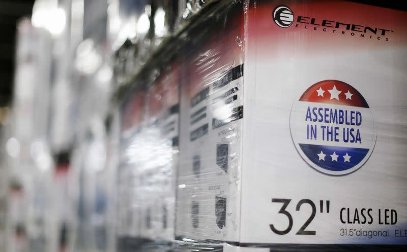 An Assembled in the USA stamp is seen at the side of a box containing a TV set in the warehouse of Element Electronics, in Winnsboro