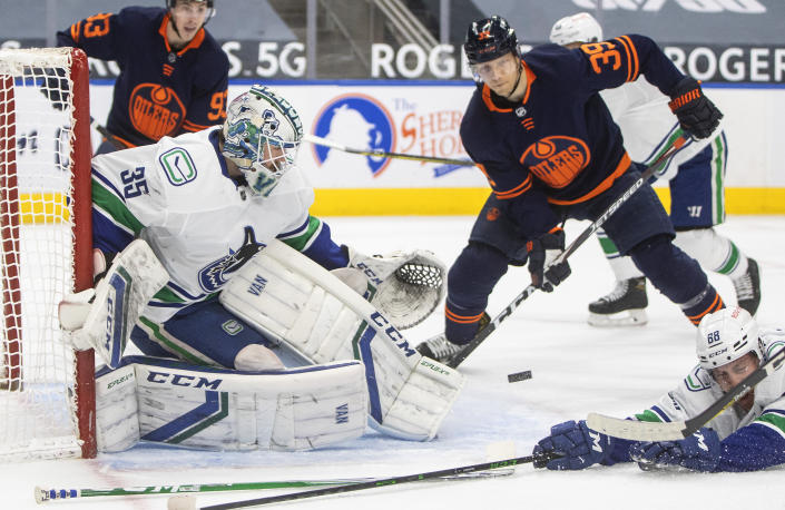 Edmonton Oilers' Alex Chiasson (39) is stopped by Vancouver Canucks goalie Thatcher Demko (35) during the second period of an NHL hockey game Saturday, May 8, 2021, in Edmonton, Alberta. (Jason Franson/The Canadian Press via AP)