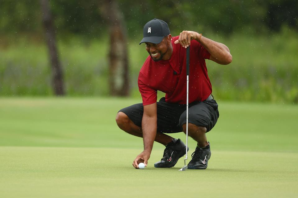 HOBE SOUND, FLORIDA - MAY 24: Tiger Woods lines up a putt  during The Match: Champions For Charity at Medalist Golf Club on May 24, 2020 in Hobe Sound, Florida. (Photo by Mike Ehrmann/Getty Images for The Match)