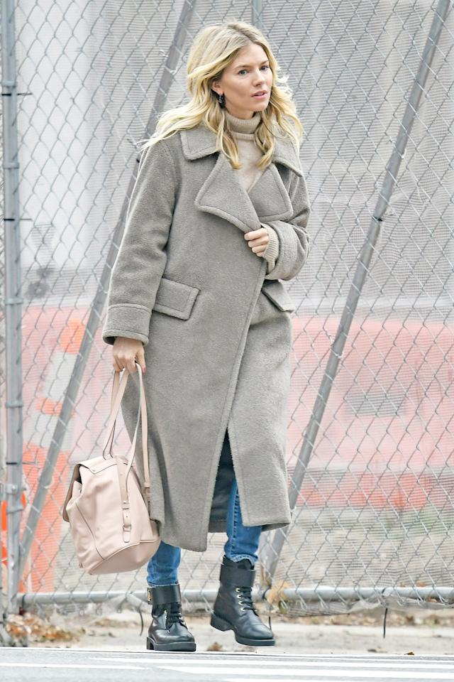 Sienna Miller shows off her signature style during a stroll through New York City on Friday.