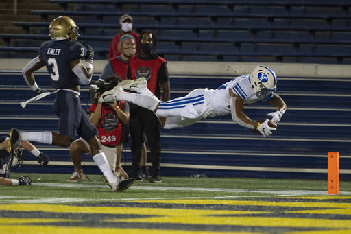 BYU rolls past Navy 55-3 in season-opener with no fans