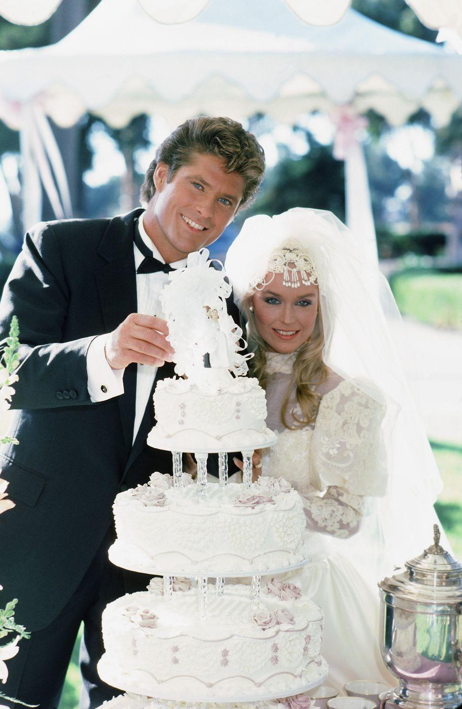 <p>Stevie Mason wore an elegant '80s wedding dress when she married her long-time love, Michael Knight (a.k.a. David Hasselhoff!) on <em>Knight Rider </em>in 1985. The lace and taffeta princess gown featured puffy sleeves and an illusion neckline, which she paired with an over-the-top beaded headpiece. </p>