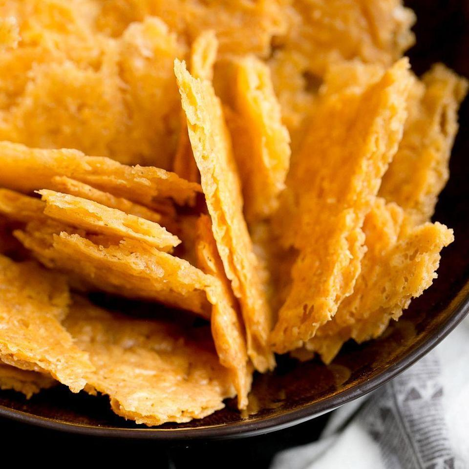 """<p>These four-ingredient cheese crackers are so crisp and delicious, you won't be able to stop eating them. If you want to add a kick, try using pepper jack cheese instead. </p><p><strong><a href=""""https://www.thepioneerwoman.com/food-cooking/recipes/a105247/sourdough-cheese-crackers/"""" rel=""""nofollow noopener"""" target=""""_blank"""" data-ylk=""""slk:Get the recipe."""" class=""""link rapid-noclick-resp"""">Get the recipe. </a> </strong></p>"""