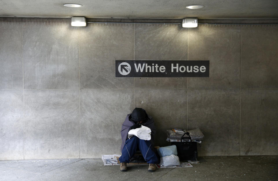 On an unseasonably cold day, a homeless person tries to stay warm at the entrance of a subway station near the White House in Washington January 20, 2016. High rent in America ultimately goes back to D.C. (Photo: REUTERS/Kevin Lamarque)