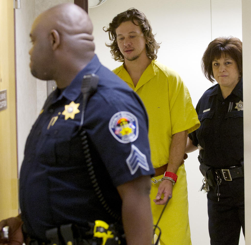 Dylan Dougherty-Stanley is escorted to court in Pueblo, Colo., on Monday, Aug. 15, 2011. The filing of charges against the three fugitive siblings captured in Colorado has been delayed until next week. (AP Photo/Pool, Mike Sweeney)