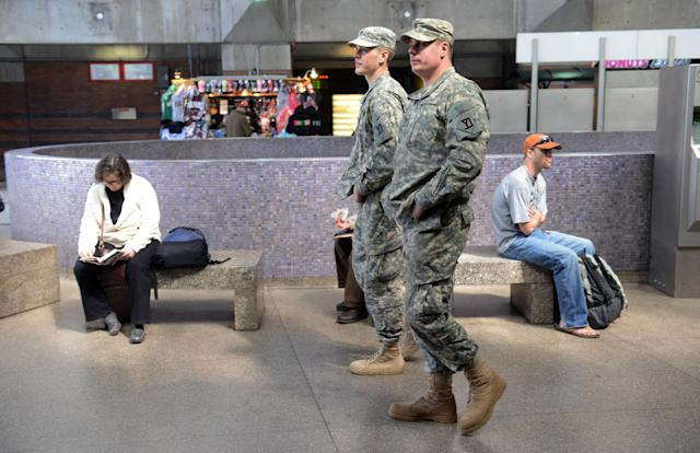 BOSTON - APRIL 16: National Guard soldiers patrol at Back Bay Station April 16, 2013 in Boston, Massachusetts. Security is tight in the City of Boston following yesterday's two bomb explosions at the finish of the Boston Marathon, that killed three people and wounding hundreds more. (Photo by Darren McCollester/Getty Images)