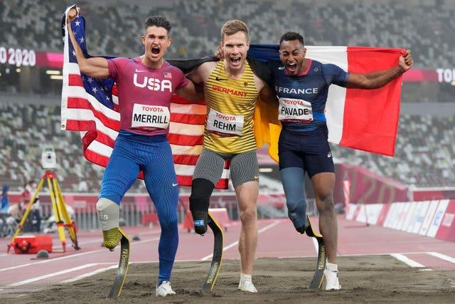Germany's Markus Rehm (centre) celebrates gold in the men's long jump T64 with silver winner Dimitri Pavade (right) and third-placed Trenten Merrill