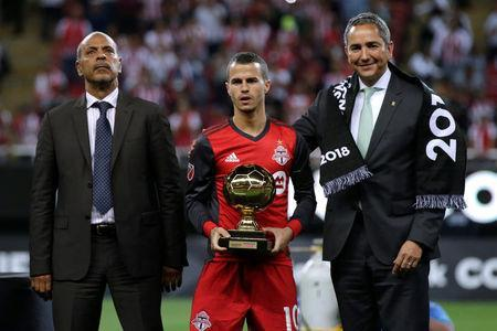 Soccer Football - CONCACAF Champions League Final Second Leg - Guadalajara vs Toronto FC - Estadio Akron, Guadalajara, Mexico - April 25, 2018 Toronto's Sebastian Giovinco poses with the Goldan Ball trophy after the match REUTERS/Henry Romero
