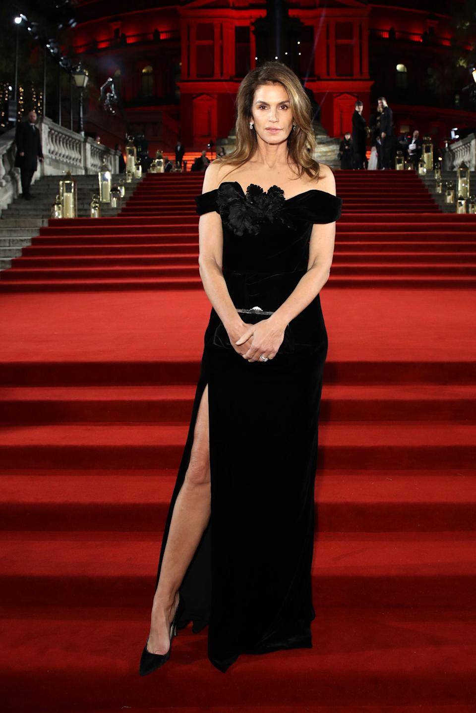 <p>Nineties model Cindy Crawford took to the red carpet in a cold-shoulder black gown with co-ordinating accessories. But it's the thigh-high split that really made the ensemble. <em>[Photo: Getty]</em> </p>