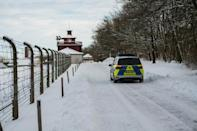 A police car drives by the memorial site of the former Nazi concentration camp Buchenwald near Weimar, eastern Germany, on the International Holocaust Remembrance Day.