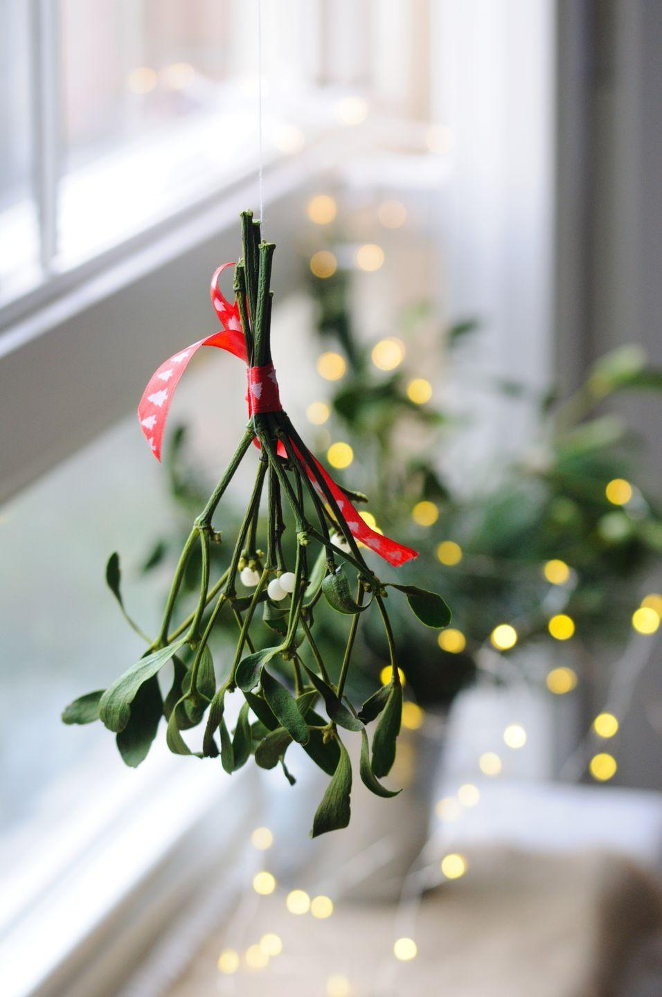 """<p>If you're coupled up, hang a ball of mistletoe in your entryway—it'll serve as a great excuse to kiss your partner every time they walk through the door. (As if you needed one!) </p><p><em>Learn how to make a Christmas kissing ball at <a href=""""https://apumpkinandaprincess.com/christmas-kissing-ball/"""" rel=""""nofollow noopener"""" target=""""_blank"""" data-ylk=""""slk:A Pumpkin and a Princess."""" class=""""link rapid-noclick-resp"""">A Pumpkin and a Princess.</a></em></p>"""