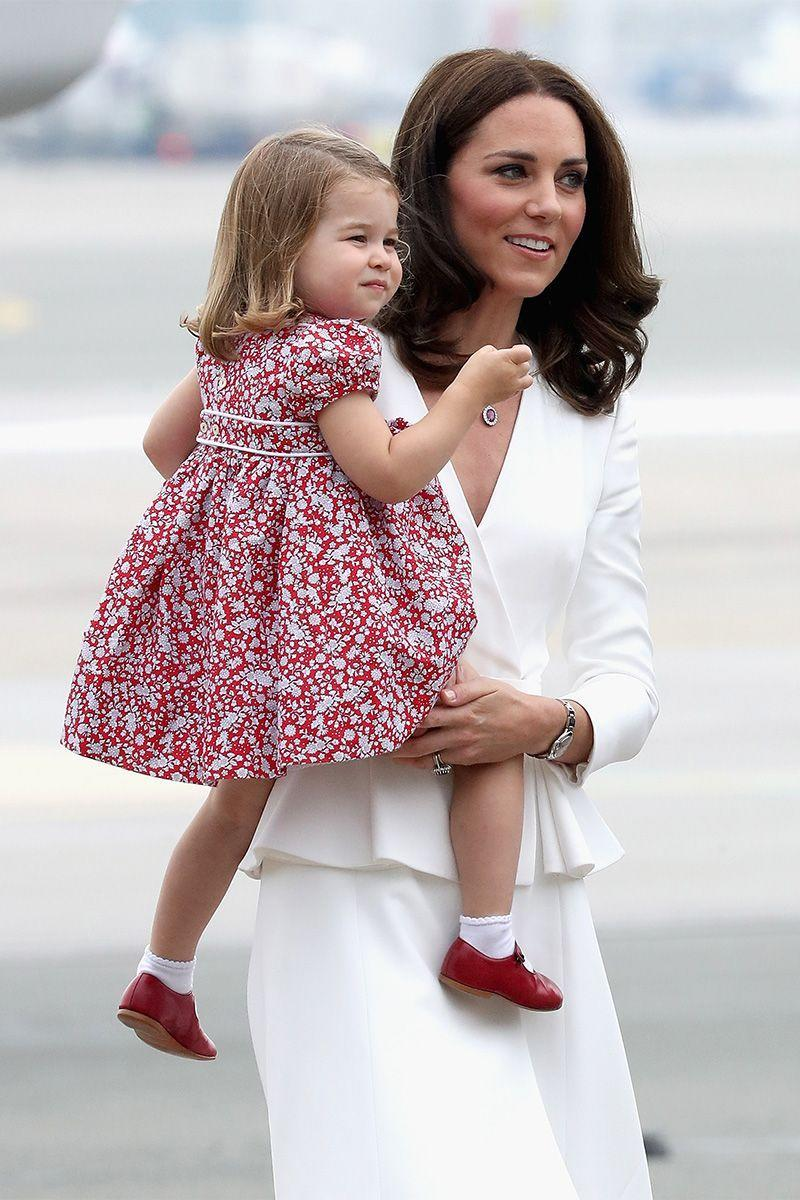<p>The Duchess of Cambridge carries Princess Charlotte as they arrive in Warsaw for their official visit to Poland and Germany.</p>