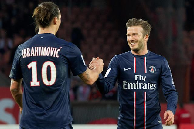 David Beckham of PSG shakes hands with team-mate Zlatan Ibrahimovic during the French Ligue 1 match between Paris Saint-Germain FC and Nancy FC at Parc des Princes on March 9, 2013 in Paris, France. (Getty)