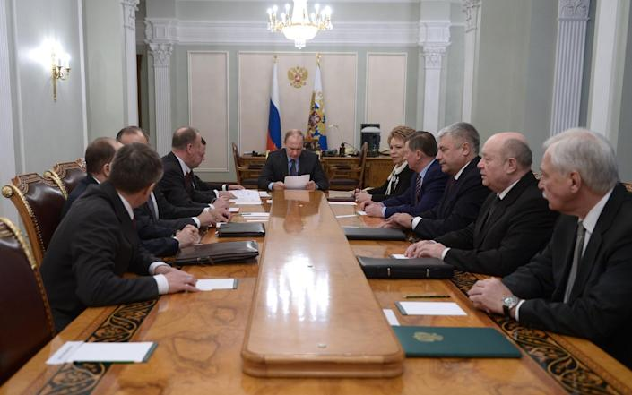 Russia's President Vladimir Putin (C) chairs a Security Council meeting at his Novo-Ogaryovo residence, outside Moscow, on February 16, 2015 (AFP Photo/Alexei Nilolsky)