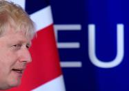 FILE PHOTO: Britain's Prime Minister Boris Johnson arrives to attend a news conference at the European Union leaders summit dominated by Brexit, in Brussels, Belgium October 17, 2019