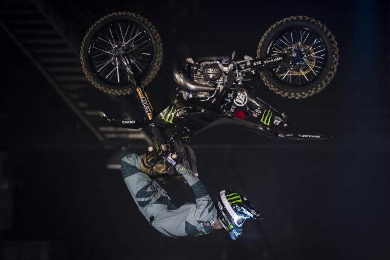 Japanese rider Taka Higashino performs during a motocross freestyle show in Tours, on April 7, 2018