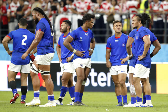 Samoan players react following their Rugby World Cup Pool A game at City of Toyota Stadium against Japan in Tokyo City, Japan, Saturday, Oct. 5, 2019. Japan defeated Samoa 38-19.(AP Photo/Shuji Kajiyama)