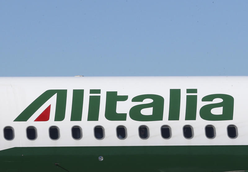 An Alitalia plane prepares to take off from Linate Airport, Milan, Italy, Friday, Oct. 11, 2013. The board of Alitalia met Friday to vote on a new rescue plan to inject 500 million euros (678 million dollars) for Italy's struggling flagship airline a day after the Italian government welcomed Italy's postal service, Poste Italiane SpA's help to re-capitalize Alitalia by injecting 75 million euros (101 million dollars). Alitalia's 62 years as a state-run company ended in bankruptcy in 2008. The present Alitalia began flying in 2009 as a new company owned by a group of Italian investors. Currently Air France is the largest shareholder with 25 percent. (AP Photo/Antonio Calanni)